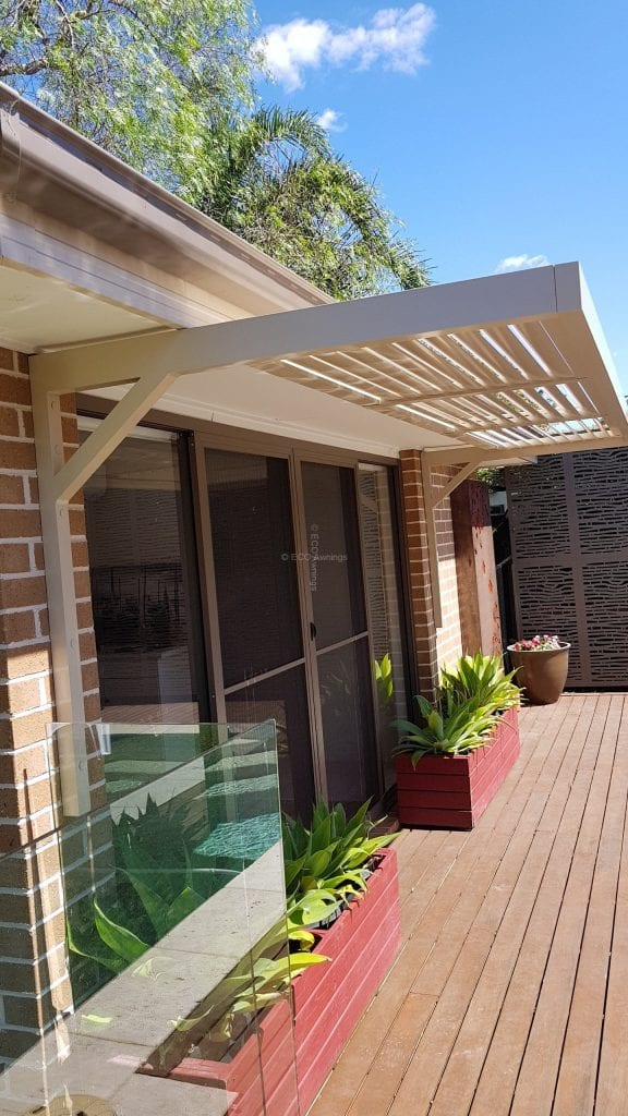 Canter Lever Louvers Mounted Above Glass Door Eco Awnings