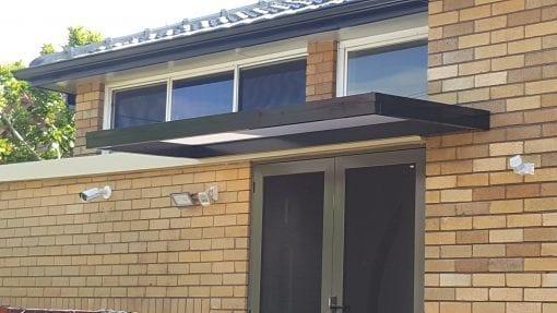 Slimline polycarb door awning