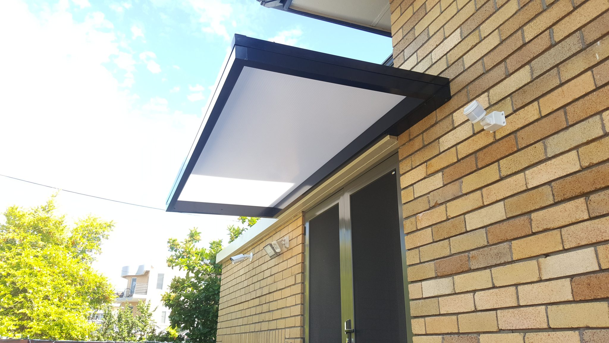 Slimline Awnings - over rear door - Eco Awnings