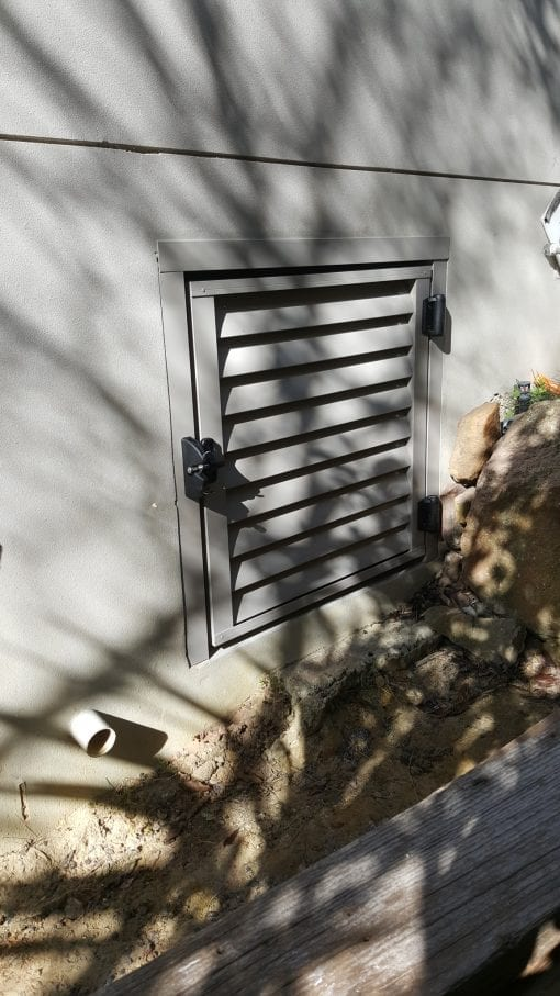 louver door for access under a house with a lock