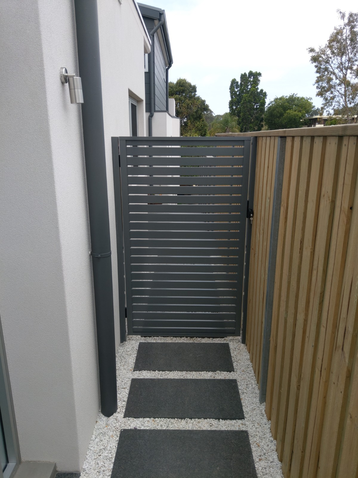 Slat Gate Mounted To The Wall And Fence Eco Awnings